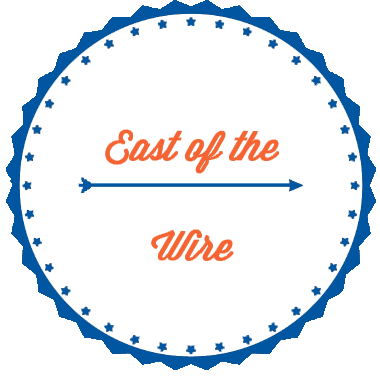 East of the Wire Logo